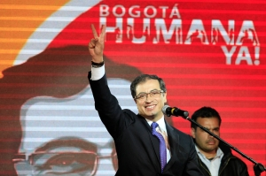Gustavo Petro gestures to supporters as he celebrates winning Bogota's mayoral race in Bogota, Colombia, Sunday Oct. 30, 2011. Voters on Sunday elected Gustavo Petro as mayor of Bogota, the first time an ex-guerrilla has won Colombia's second most important elected office.  (AP Photo/Fernando Vergara) Colombia Election